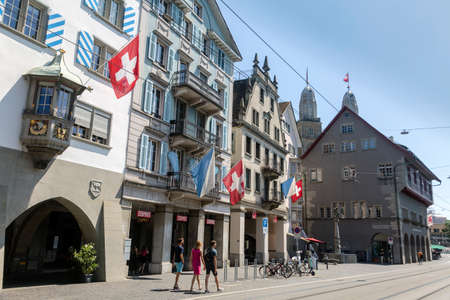 A view of historic city center of Zurich with Swiss flags, Switzerland