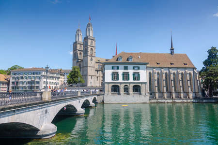 Zurich, Switzerland - 1 August, 2019: Panorama view of historic city center of Zurich with Fraumunster Church and Munsterbucke crossing river Limmat