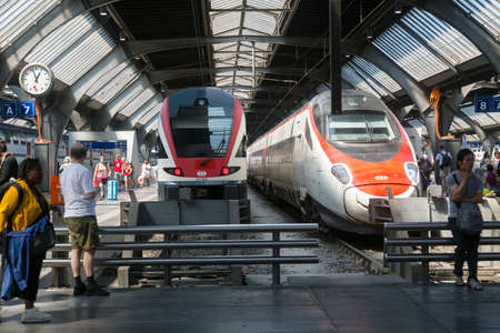 Zurich, Switzerland - 1 August, 2019: tourist are waiting near the modern swiss transport trains at the station Editorial