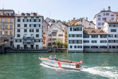 Zurich, Switzerland - 1 August, 2019: police boat on the Limmat river in historic city center