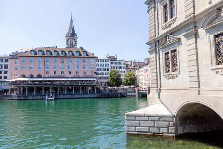 Zurich, Switzerland - 1 August, 2019: view on the Stadthausquai quay over the Limmat river