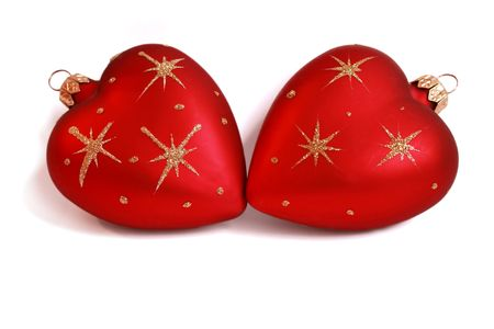 highkey: Two Christmas baubles with heart form laying together isolated on white