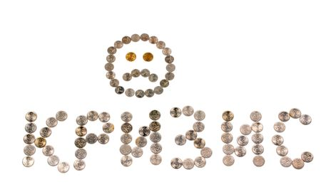 Inscription crisis and a sad smiley face lined from coins