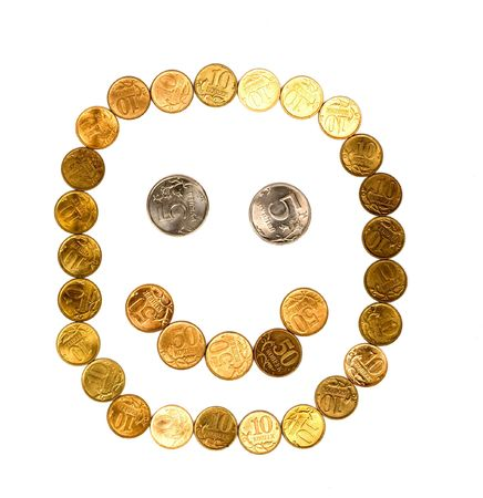 smile composed of coins on white background