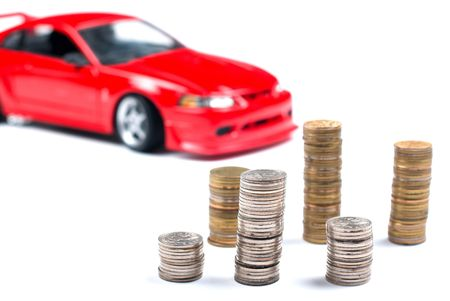 Coins and a red sports car on a white background Stock Photo