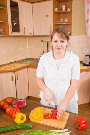 The girl cuts pepper
