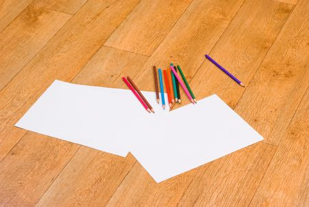 Colour pencils and white paper Stock Photo