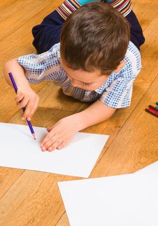 The boy draws pencils Stock Photo