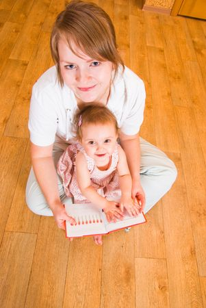 Mum and daughter look the book Stock Photo