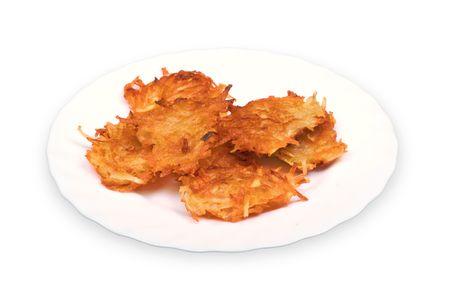 Potato fritters on plate Stock Photo