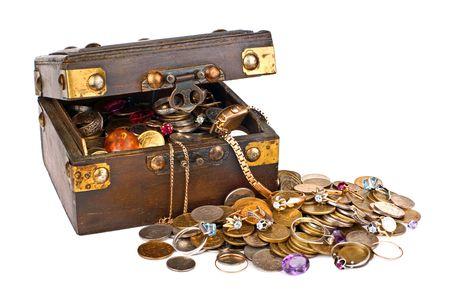 Full box of treasures isolated on white background photo