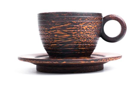 Cup and saucer made of natural wood Stock Photo