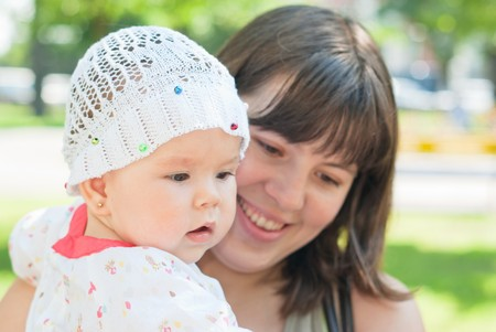 portrait of happy mother and little daughter in the park Stock Photo - 7475472