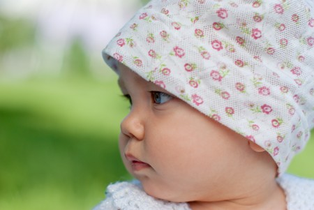 Portrait of a baby outdoors, close-up