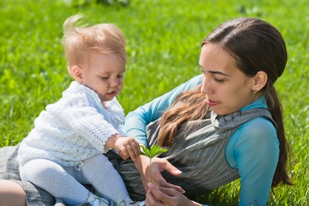 Mother and young daughter in the meadow Stock Photo