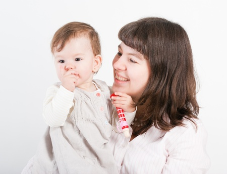 Portrait of mum with a daughter on a white background