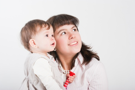 Portrait happy mums with a daughter on a white background