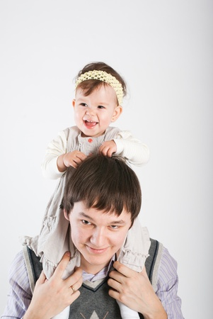 The little girl lives off the happy father  photo