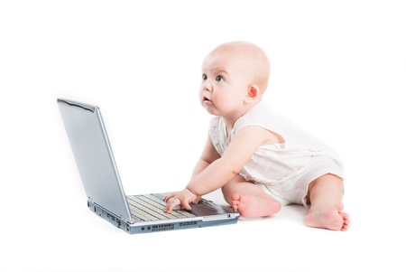The little girl with the laptop Stock Photo - 8606453