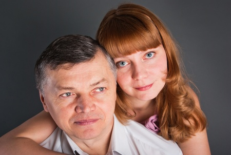 Portrait of the man and the woman on a gray background