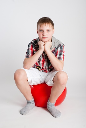 Portrait of the boy on fitball