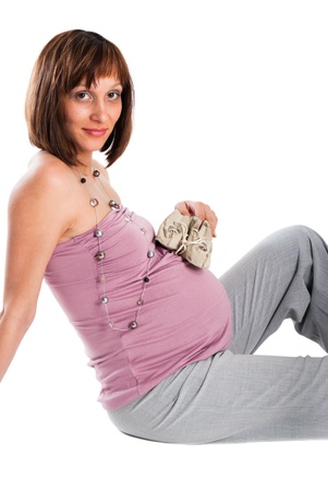 bootees: The pregnant woman with bootees on a white background