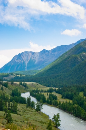 The river flows between the mountains  Stock Photo