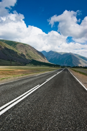 The road against the background of mountains Stock Photo