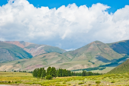 View from the valley to the mountain summer landscape. Stock Photo