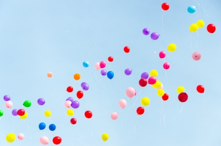 A lot of multi-colored balloons into the sky. Stock Photo
