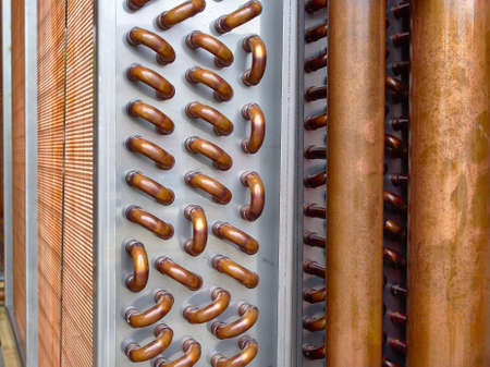 Close up shot of copper tubes of a condenser coil.