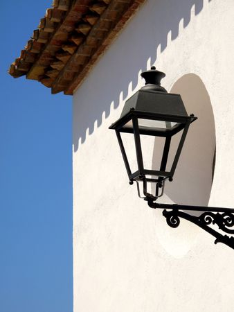 Classic lantern on a white wall