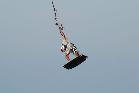 jumping kitesurf over wawes and sky