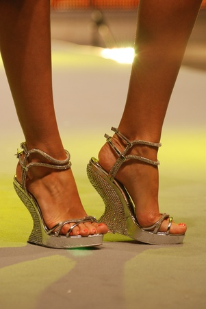 model wearing fashionable shoes on the catwalk