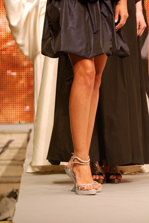 models wearing fashionable shoes on the catwalk