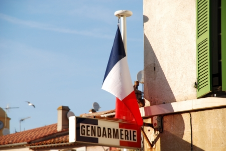French flag and sign the police station