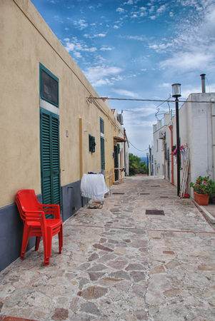 red chair on the street st nicholas island italy