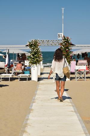 Girl on beach walkway Stock Photo