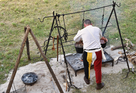 medieval camp kitchen with cook