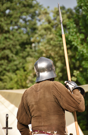 medieval soldier with helmet and spear