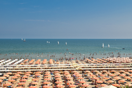 Riccione beach with people in the sea Editorial