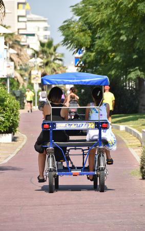 girls pedaling on a rickshaw