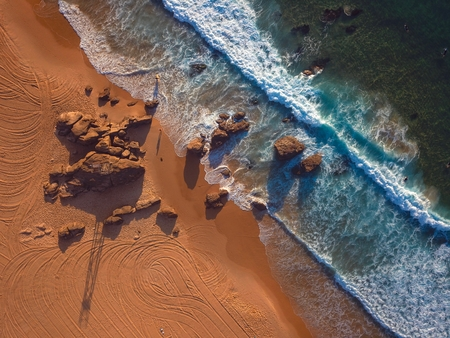 Drone Shot of a beach at sunrise Stock Photo - 93330621