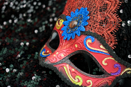 Carnival mask in black shiny background with copy space
