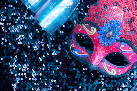 Carnival mask in black shiny background with two glasses and copy space Stock Photo