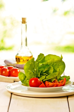 oil bottle: salad with oil bottle and tomatoes