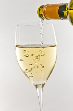 full bodied: pouring glass of whitewine