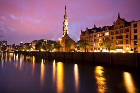 Hamburg warehouse district with St Annen Church in night mood