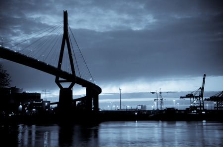 freeport: Hamburg Germany, Koehlbrandbridge in the evening, the bridge is a landmark from the 70ties, black and white photo