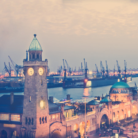 Hamburg in the evening at landing bridge historic architectre, in the retro style and toning instagram filter photo